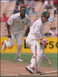 Malcolm clean-bowls Australia's Michael Slater