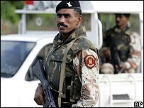 Pakistani paramilitary troops stand on alert