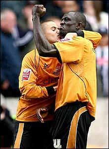 Wolves' Seyi George Olofinjana is congratulated