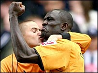 Seyi Olofinjana (right) celebrates scoring for Wolves