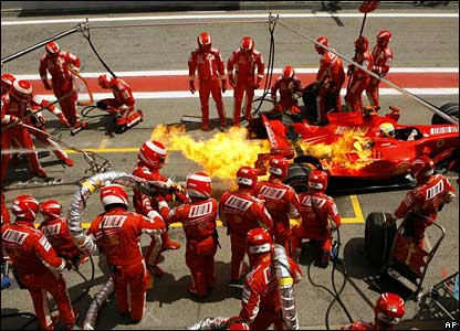 Flames flare on Felipe Massa's Ferrari