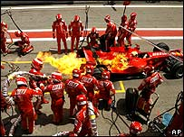 Felipe Massa pulls out of the pits with his Ferrari on fire during the Spanish Grand Prix