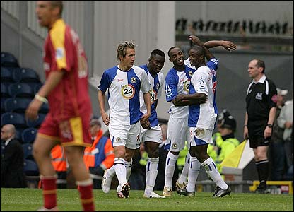 Blackburn's players congratulate Benni McCarthy