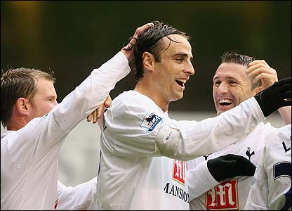 Dimitar Berbatov is congratulated by his Spurs team-mates