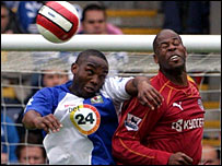 Blackburn's Benni McCarthy and Reading's Michael Duberry