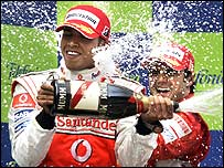 Lewis Hamilton celebrates on the podium of the Spanish Grand Prix with race winner Felipe Massa