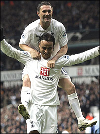 Robbie Keane celebrates with Dimitar Berbatov
