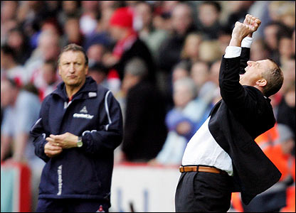 Blades boss Neil Warnock looks on as Wigan boss Paul Jewell celebrates