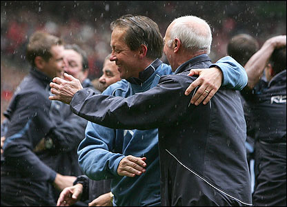 West Ham boss Alan Curbishley celebrates with his staff