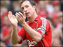 Liverpool striker Robbie Fowler applauds the Anfield crowd as he is given a standing ovation as he comes off after being substituted in the 2-2 draw with Charlton