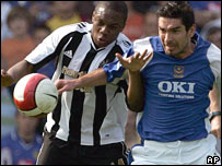 Newcastle's Charles N'Zogbia and Portsmouth's Richard Hughes