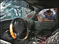 Children look into the car where Baha Abu Jarab was killed