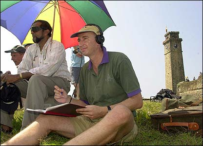 Johnathan Agnew commentates from the fort ramparts after the BBC were kept out of the ground due to contractual agreements on the second day of the first Test against Sri Lanka in Galle