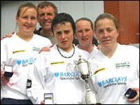 Wirral Ladies celebrate winning the Your Game event in Liverpool with former Reds star Alan Kennedy