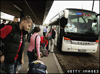 Polish people boarding a coach to Britain