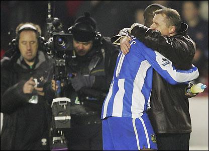 Jewell embraces Jason Roberts after the semi-final at Arsenal