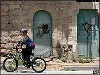 Settler child cycling through deserted Old City