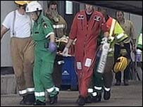 Paramedics carrying Mr Thompson