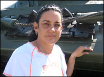 Barbara Sierra, director of the Bay of Pigs museum, by a tank used in the battle