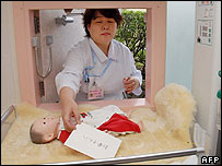 "Nurse demonstrates Japan's ""baby hatch"" on 1 May 2007"