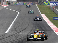 Heikki Kovalainen leads Nico Rosberg's Williams during the Spanish Grand Prix