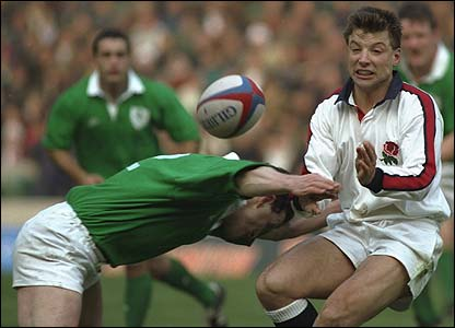 Rob Andrew of England releases the ball as he is tackled during the Five Nations match against Ireland