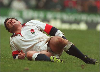 England captain Will Carling holds his leg after getting injuried during the England v Ireland Five Nations International match at Twickenham