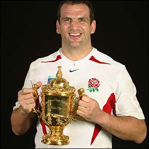 England captain Martin Johnson proudly displays the World Cup