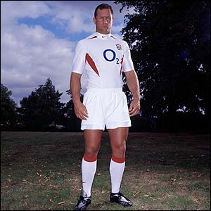 Richard Hill displays England's new shirt in August 2003
