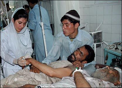 Pakistani nurses provide initial treatment to the injured victims