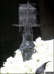 A hat on a mannequin's head adorns Isabella Blow's coffin