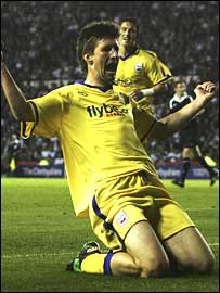 Grzegorz Rasiak celebrates his late goal