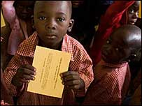 Togolese children with cards -  Copyright - Olivier Asselin/WHO
