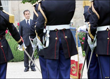 Mr Sarkozy reviews the troops at the Elysee Palace