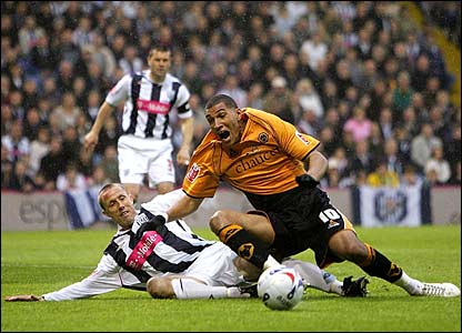 Jay Bothroyd is tackled by West Brom's Chris Perry