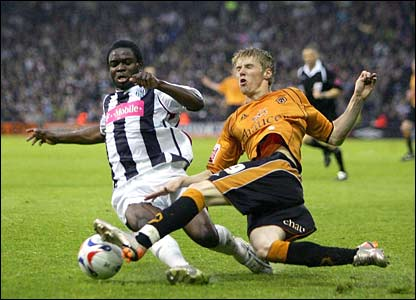 Sam Sodje of West Brom and Andrew Keogh of Wolves