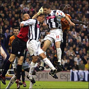 West Brom keeper Dean Kiely punches clear