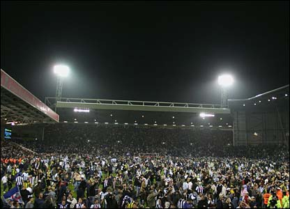 Fans on the pitch at West Brom