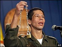 Jhon Frank Pinchao shows a chain similar to the one rebels tightened around his neck