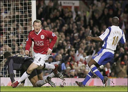 Rooney scores during Man Utd's 2-1 win