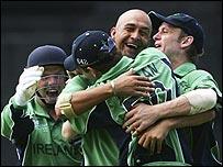 Ireland celebrate their three-wicket win