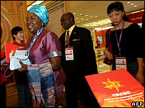 African and Chinese delegates arrive for the African Development Bank meeting in Shanghai on 16 May 2007