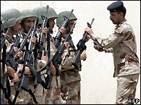 Iraqi army recruits receive their rifles