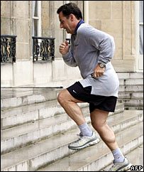 Nicolas Sarkozy jogs back to the Elysee Palace