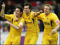 Stuart Campbell celebrates his goal with Byron Anthony and Chris Carruthers