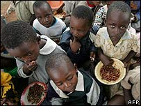 Zimbabwean children eating rations of beans