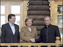 From left to right: European Commission President Jose Manuel Barroso, German Chancellor Angela Merkel and  Russian President Vladimir Putin at the Volzhsky Utyos resort