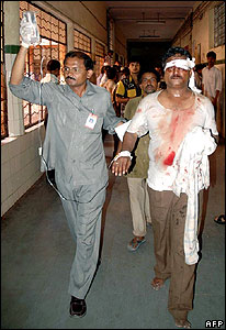 A wounded man arrives for treatment at a hospital in Hyderabad