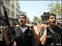 Hamas members carry the body of Talat Haniya, a member of the Hamas executive force, in Gaza City