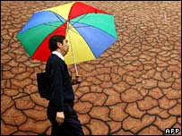 Man walks past drought mural in Melbourne